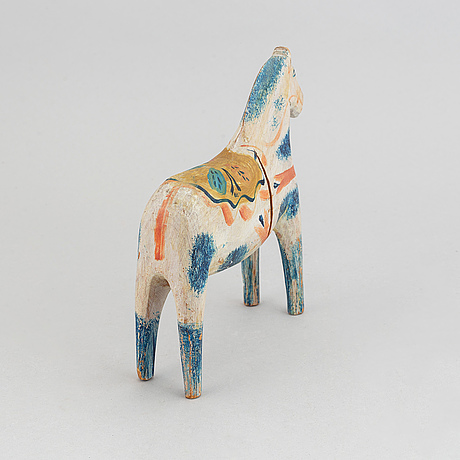 A wooden carved and painted 'dalahäst', early or mid 20th century.
