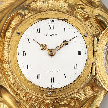 A late 19th century gilt bronze miniature wall clock, clock face signed breguet a paris.