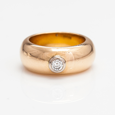 An 18k gold ring with a ca. 0.22 ct diamond. b. ahlfors, helsinki 1971.
