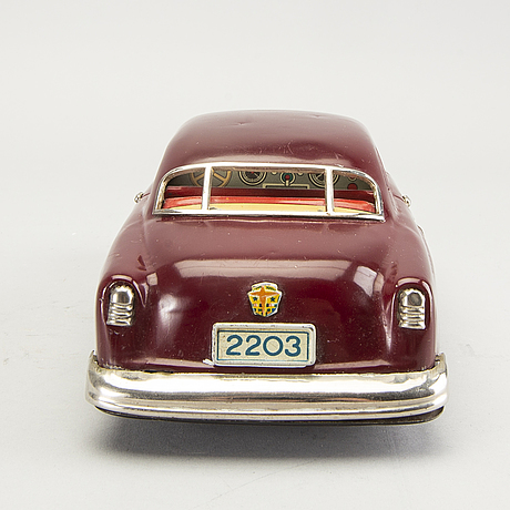 A ford toy car marusan toys japan mid 1900s.