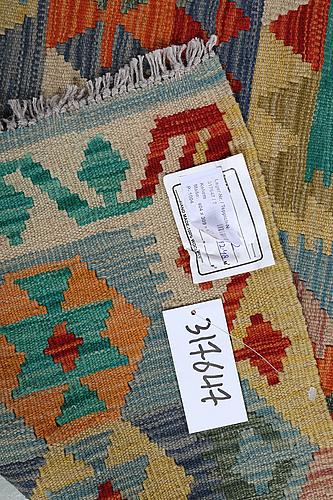 A carpet, kilim 404 x 309 cm.