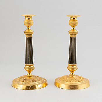 A pair of French Empire candlesticks.