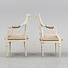 A set of two gustavian arm chairs from the early 19th century.