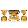 A set of three french empire early 19th century gilt bronze centre pieces.