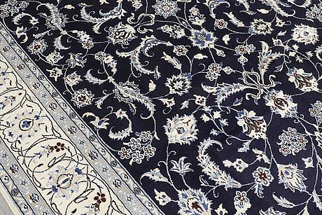 A carpet, nain, part silk, ca 350 x 247 cm.