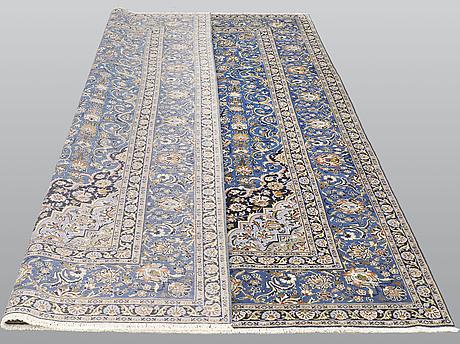 A carpet, kashan signed, ca 340 x 230 cm.