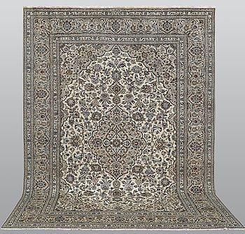 A carpet, Kashan signed, ca 352 x 245 cm.