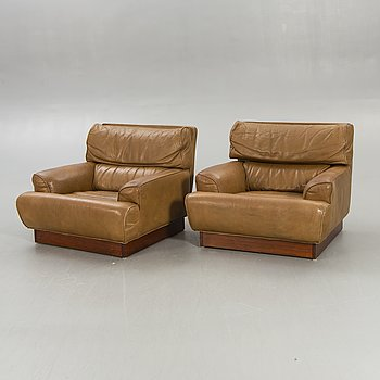 Arne Norell, armchairs, a pair, buffalo leather, second half of the 20th century.