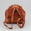 Gucci, a leather backpack.