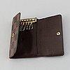 Louis vuitton, a green taiga wallet and a damier ebene key holder.