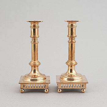 A pair of brass candle holders from Ekbergs malm, second half of the 20th century.