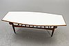 A 1960s teak and laminate probably danish coffee table.