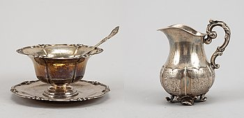 A swedish silver sauce bowl, sauce spoon and  creamer, 19th century.