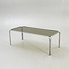 A 1980s glass and chrome coffee table.