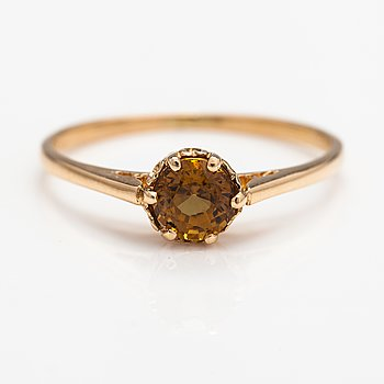 A 14K gold ring with a garnet.