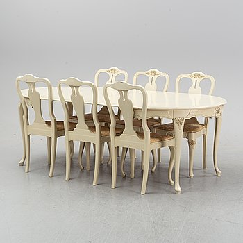 A rococo style dining group, table and six chairs, first half of the 20th century.
