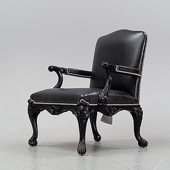 A contemporary Clivedon Carved Chair from Ralph Lauren Home.