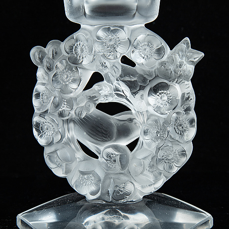 Lalique, a pair of glass candlestick, signed lalique france, second half of the 20th century.