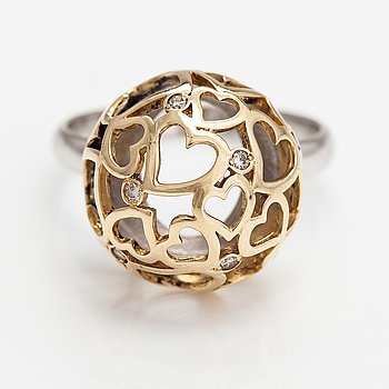 A 14K gold ring with diamonds ca. 0.012 ct in total. Moscow.