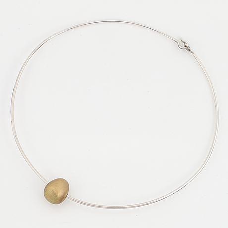Gunilla lantz, silver and gilded egg necklace.