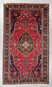 A carpet, semi-antique/Old Bakthiari, ca 305 x 175 cm.