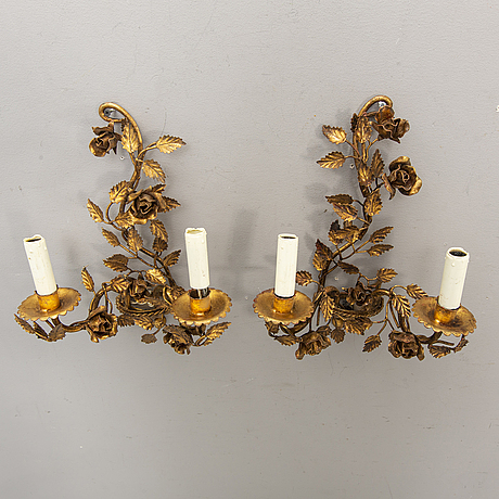 A set of four bronzed rococo-style walls scones mid 1900s.