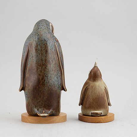 Gunnar nylund, two stoneware figurines of penguines for rörstrand, signed.