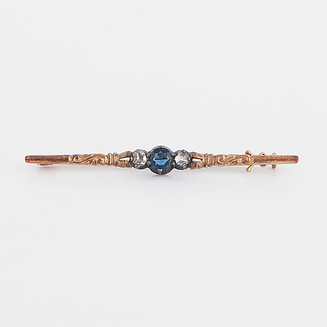 Synthetic blue stone and rose-cut diamond brooch.