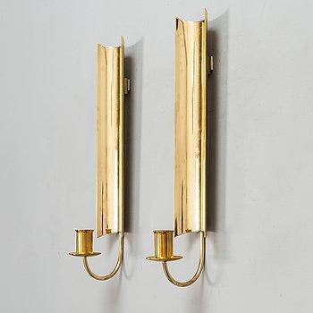 """Pierre Forssell, a pair of brass wall lamps """"Reflex"""", Skultuna, Sweden."""