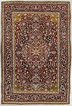 An antique Teheran carpet ca 204 x 134 cm.