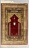 A signed silk hereke carpet with metal thread in relief ca 128 x 80 cm.
