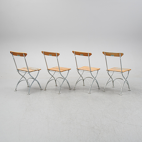 A set of four chairs and one table, grythyttan, late 20th century.