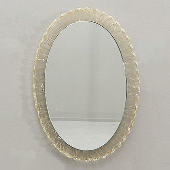 A mid 1900s plastic mirror.