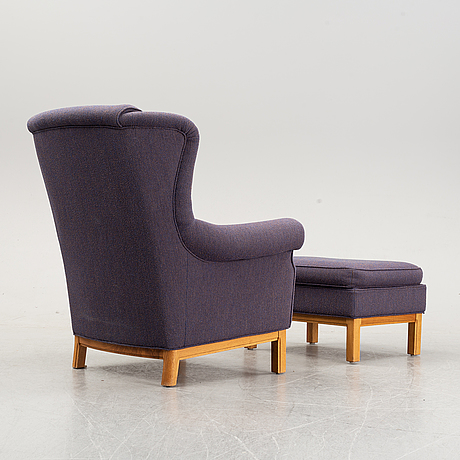 Easy chair and foot stool by arne norell, late 20th century.