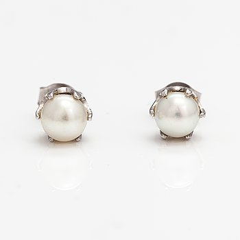 A pair of 14K white gold earrings with cultured pearls.