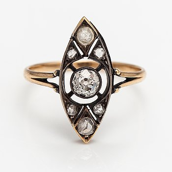A 14K gold ring wtih an old-cut diamond ca. 0.25 ct, rose-cut diamonds and a synthetic stone. Russia.