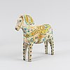 A painted swedish wooden horse from the first half of the 20th century.