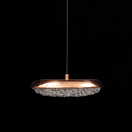 An 'origo' pendant lamp from manooi.