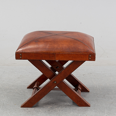 A contemporary dressing table with stool.