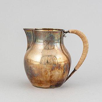A silver milk jug by Hans Hansen, Denmark, 1957.