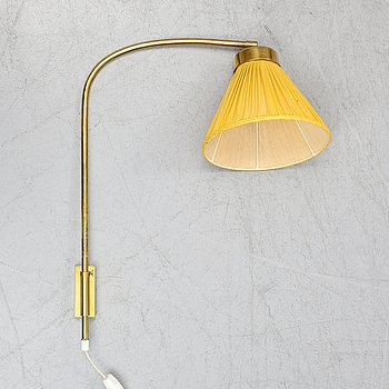 A model 2484 brass wall light by Josef Frank for Firma Svenskt Tenn.