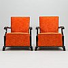 A pair of 1930's armchairs.