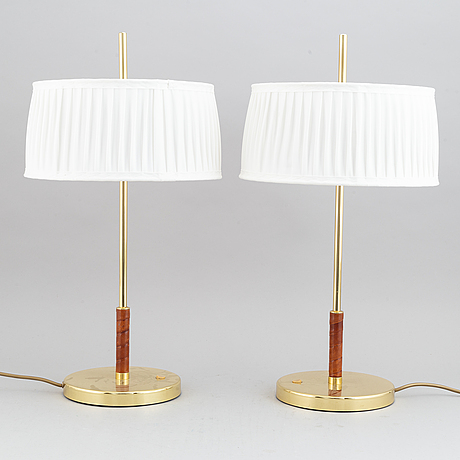 A pair of brass and leather table lights, 21st century.