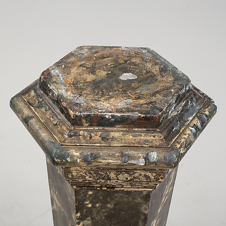 An early 20th century wooden pedestal with a marble base.