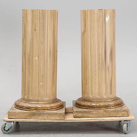 A pair of gustavian style columns, circa 1900.