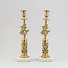 A pair of empire style candle holders, marble and brass, arouend the year 1900.
