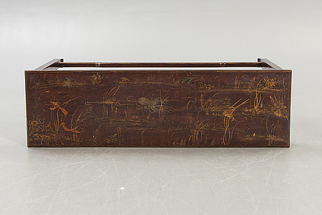 A chinese lacquered wooden sideboard around 2000.
