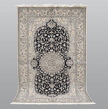 A carpet, Nain part silk s.k 9LAA, ca 246 x 150 cm.
