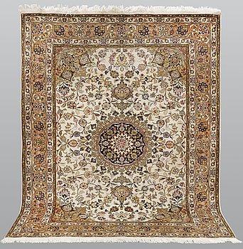 A rug, Tabriz part silk so called 50 radj, ca 200 x 152 cm.