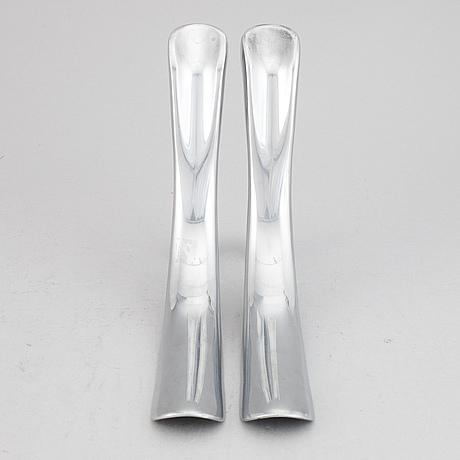 Manolo blahnik, a pair of metal shoe horns, 21st century.